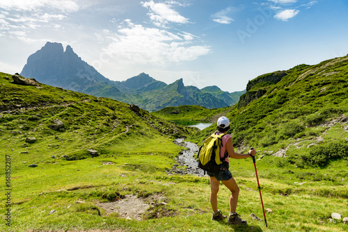 Fotobehang Pistache mature woman hiking in the Pyrenees mountains