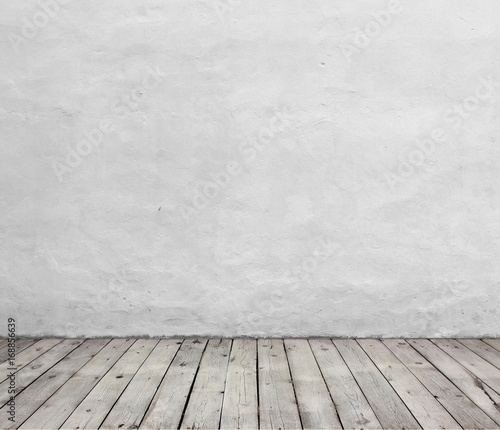 Old white wall and wood floor.