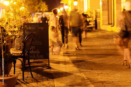 Poster Oranje eclat beautiful view of illuminated street cafe in Tbilisi at night