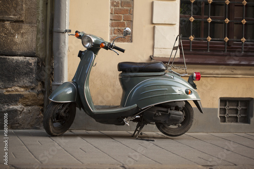 Aluminium Scooter Motor scooters, parked in front of the building wall