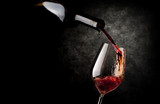 Wineglass on a black background - 168922872