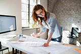 Portrait of young female architect working on project - 168928683