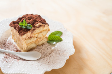 homemade tiramisu cake on wood background