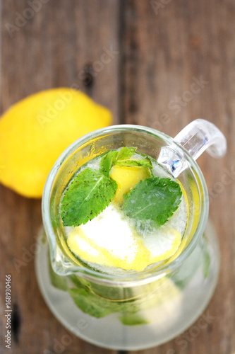 top view of Jar with fresh mint lemonade on wooden table