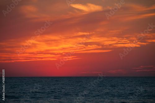 Poster Oranje eclat Orange Sunset on the sea horizon, skyline