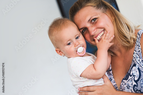 Portrait of smiling mother holding her baby