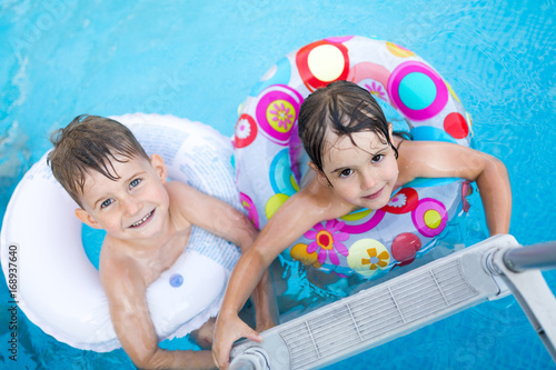 Picture of little kids enjoying in swimming pool