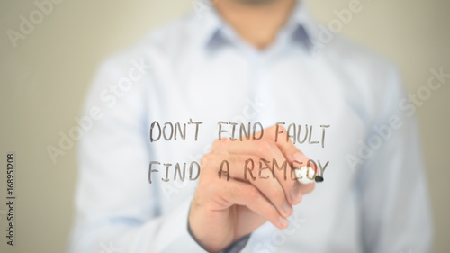 Don't Find Fault, Find a Remedy, Man writing on transparent screen