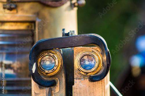 Fotobehang Schip Old nautical binocular and ship light on a market
