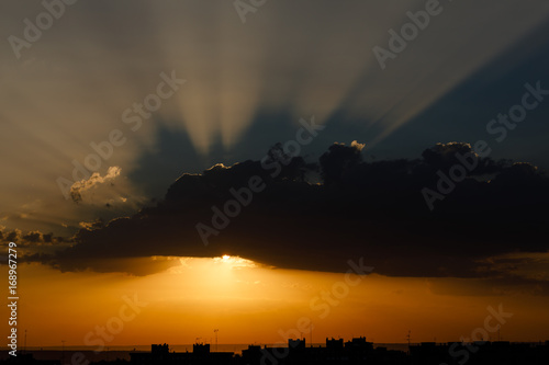 Sunlight through the clouds in the morning of the city of Madrid, Spain
