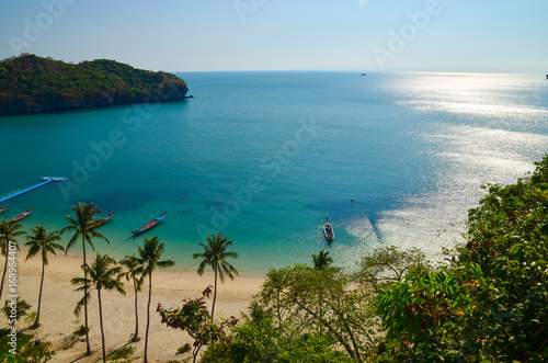 A high angle beautiful view of Angthong Island National Park in Surat Thani, Thailand with reflection of bright and clear blue sky. Scenery of beautiful sea at gulf of Thailand with pier and anchored