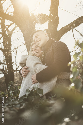 Happy couple enjoying together in outdoors.  Couple in hug.