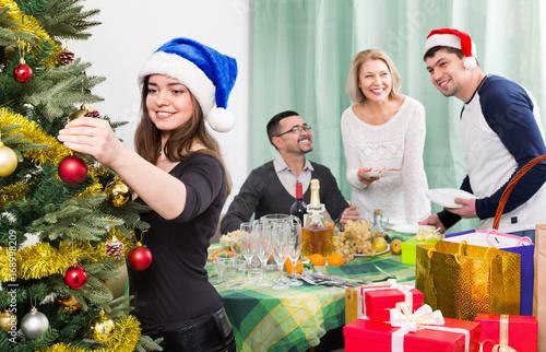 Happy smiling family setting table for dinner