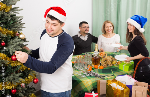 Parents with  kids preparing for Christmas  in home