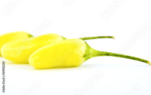 Set of yellow hot chili peppers isolated on white background, shallow dof