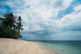 White Sand Beach and Turquoise Water with Palm Tree in Borneo