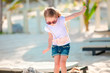 Quadro Adorable happy smiling little girl on beach vacation
