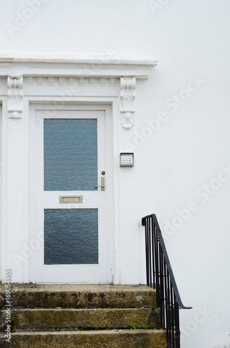 stylish entrance to a residential building, an interesting facade, a typical old English buildings