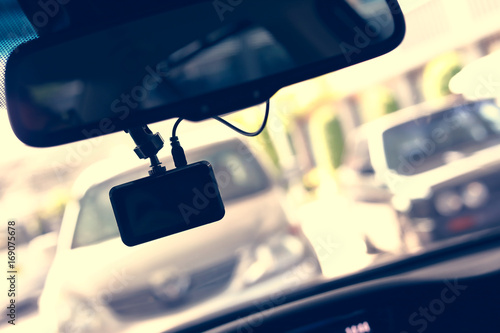 Plakat driving car with video camera record technology on windscreen