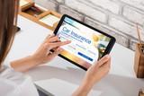 Businesswoman Filling The Car Insurance Form On Digital Tablet