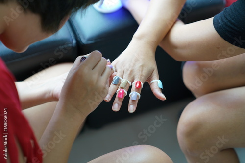 Fotobehang Manicure Manicurist painting nails in manicure nail salon
