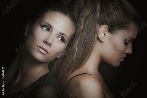 portrait of two young delicate women studio
