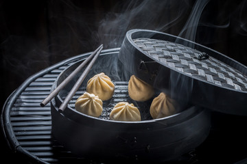 Closeup of chinese dumplings on black background