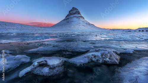 The picturesque sunset over landscapes and waterfalls. Kirkjufell mountain,Iceland - 169097266