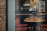 Coffee shop glass door mockup. Empty space on window for add logo