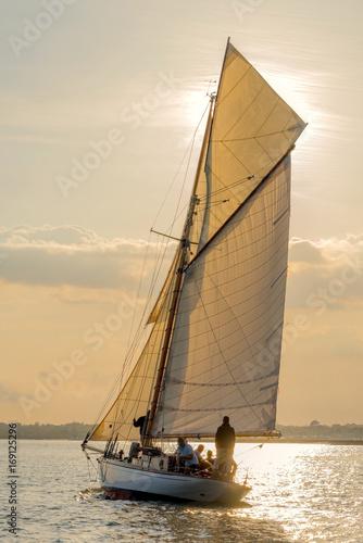 Yacht sails toward the sun   Buy Photos   AP Images   DetailView