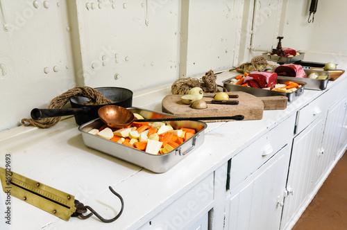 Fotobehang Schip Food being prepared in a ship's galley.