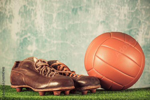 Retro outdated soccer spike boots and football Poster