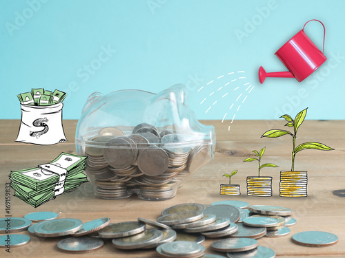 transparent see through piggy bank filled with coins on wood background.