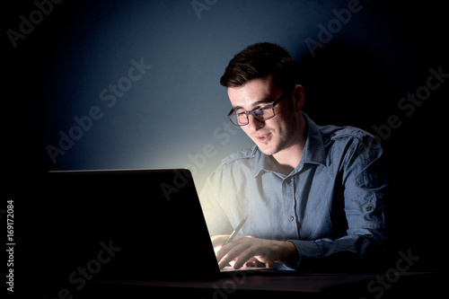 Businessman in the office at night Poster