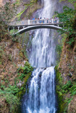 PORTLAND, OR - AUGUST 19TH, 2017: Tourists enjoy Multnomah Falls. It is a waterfall on the Oregon side of the Columbia River Gorge, along the Historic Columbia River Highway - 169176225