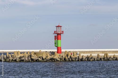Fotobehang Vuurtoren lighthouse of Swinemuende from river swine
