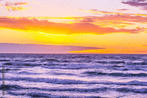 Beautiful sunset over rough ocean seas - nothing but sky and water