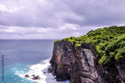 Fotobehang Purper Bali cliff over ocean