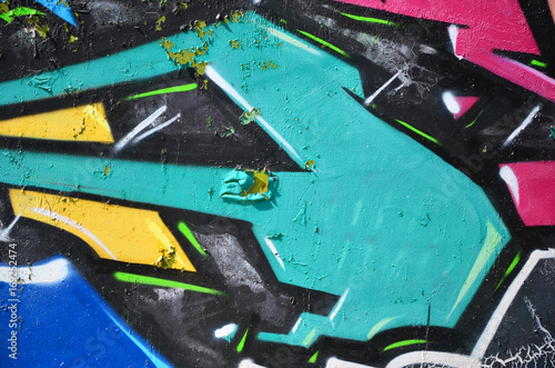 The old wall, painted in color graffiti drawing green aerosol paints Poster