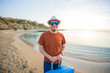 Quadro Man with suitcase on the beach. Summer travel and vacation concept