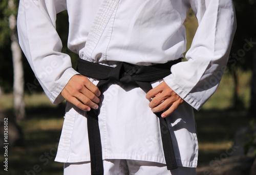 Tie a black belt Poster