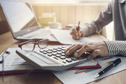Wall mural Businessman working on Desk office business financial accounting calculate