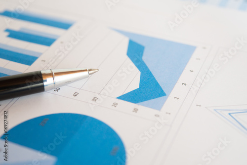 Pen on a business report