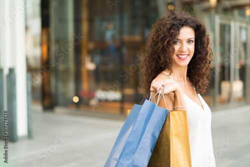 Woman shopping in a city plaza