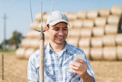 Farmer using his phone
