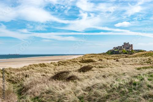 Fotobehang Pool Grass covered dunes at Bamburgh Northumberland
