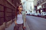 Young urban girl posing on sidewalk