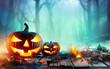 Pumpkins Burning In A Spooky Forest At Night - Halloween Background  - 169325814