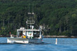 Lobster boat heads out for a beautiful days work in South Bristol, Maine, United States
