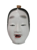 Face of Traditional japanese theater masks made of Seramic on white background